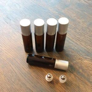 Essentiële olie roller flesjes 10ml amber bruin glas zilveren dop + rvs roller (5 stuks)